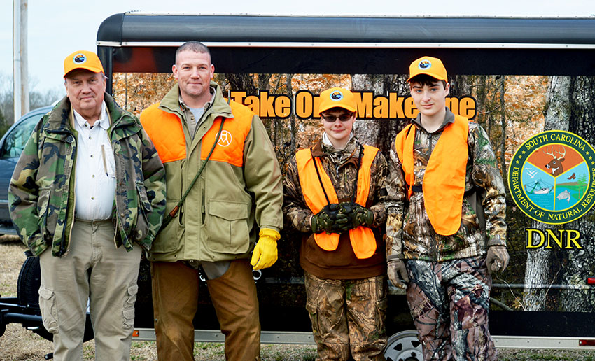Left to right: Michael Fry, Jeff Fry, Colton Parks, and Kaleb Makin at a recent TOMO quail hunt at High Meadows Hunting Preserve.